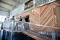 "Green Horizon Manufacturing specializes in ""on-demand, self-sustaining housing and commercial facility solutions."" Their show house at West Coast Green features their single family home model (2 bedroom, 1 bath, 510 square feet). West Coast Green is the nation's largest conference and expo dedicated to green innovation, building, design and technology. The conference featured over 300 exhibitors, 125 speakers, and 80 education and networking sessions. Fort Mason, San Francisco, California, USA. Photo taken October 2, 2009."