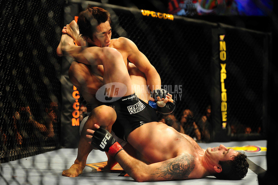 Jan. 31, 2009; Las Vegas, NV, USA; UFC fighter Dong Hyun Kim (top) against Karo Parisyan (black trunks) during the welterweight bout in UFC 94 at the MGM Grand Hotel and Casino. Mandatory Credit: Mark J. Rebilas-