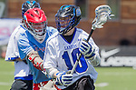 Orange, CA 05/17/14 - Jesse Gilbert (Grand Valley State #10) and Nilan Anderson (St John University #5) in action during the 2014 MCLA Division II Men's Lacrosse Championship game between Grand Valley State University and St John University at Chapman University in Orange, California.  Grand Valley Defeated St John 12-11.
