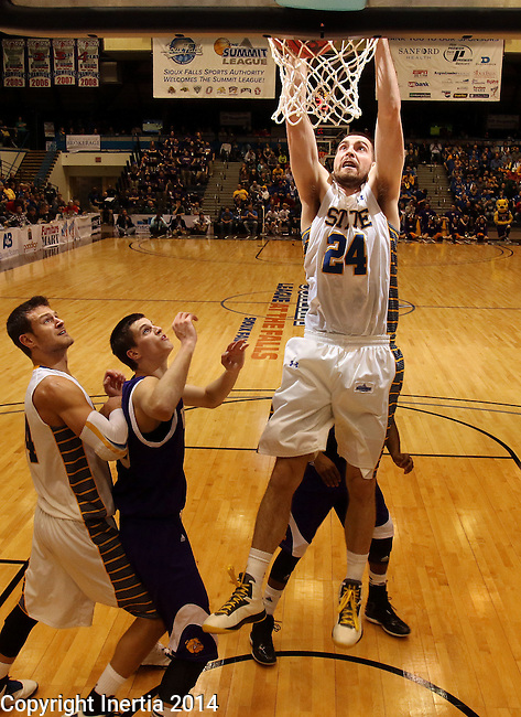 SIOUX FALLS, SD - MARCH 9:  Zach Horstman #24 from South Dakota State University slams home two points against Western Illinois in the second half of their quarterfinal game at the 2014 Summit League Tournament Sunday evening in Sioux Falls, SD. (Photo by Dave Eggen/Inertia)