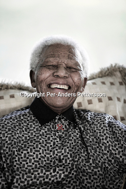 MAPUTO, MOZAMBIQUE : Former President Nelson Mandela of South Africa relaxes while on holiday in June in Maputo, Mozambique. He is retired and takes time off with his wife Graca Machel in her residence in central Maputo. The ANC freedom fighter spent 27 years in prison, and was released in 1990. He became President of South Africa after the first multiracial democratic elections in April 1994. Mr. Mandela retired after one term in 1999 and gave the leadership to the current president Mr. Thabo Mbeki. (Photo by Per-Anders Pettersson).