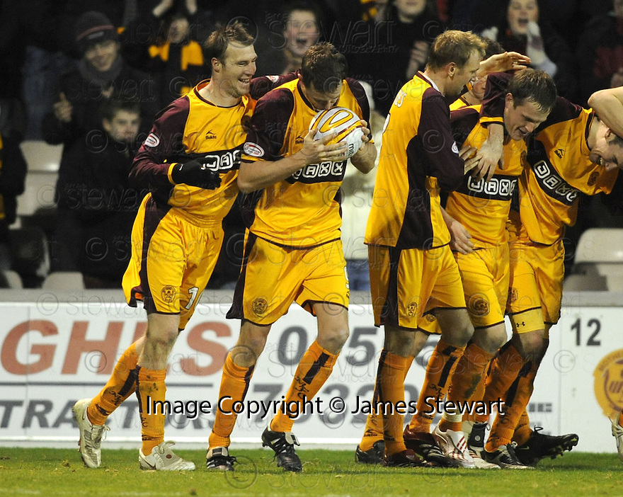27/12/2008  Copyright Pic: James Stewart.File Name : sct_jspa18_motherwell_v_ICT.CHRIS PORTER GETS THE MATCH BALL FROM DAVID CLARKSON AFTER HE SCORES HIS THIRD.James Stewart Photo Agency 19 Carronlea Drive, Falkirk. FK2 8DN      Vat Reg No. 607 6932 25.Studio      : +44 (0)1324 611191 .Mobile      : +44 (0)7721 416997.E-mail  :  jim@jspa.co.uk.If you require further information then contact Jim Stewart on any of the numbers above.........