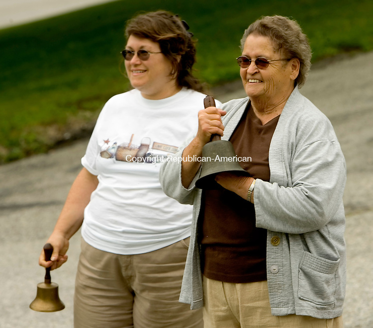 WARREN, CT --JULY 04, 2008-070408JS06-Warren residents Jan Tanner, left, and Anita Cornish wait for the bell ringing to begin during the annual Warren Independence Day bell ringing ceremony Friday. The event was sponsored by the Warren Historical Society. <br /> Jim Shannon/Republican-American