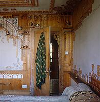 Looking towards the open bedroom door surrounded by tiered fretwork shelves
