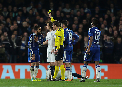 09.03.2016. Stamford Bridge, London, England. Champions League. Chelsea versus Paris Saint Germain. Chelsea Midfielder Cesc Fàbregas receives a yellow card from Referee Felix Brych for rough challenge on Paris St. Germain Midfielder Thiago Motta
