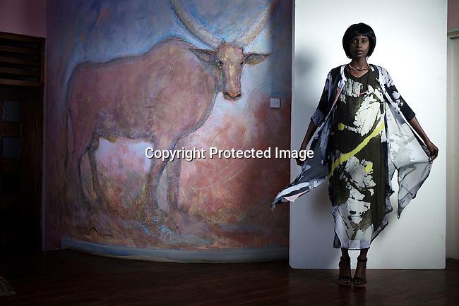 NAIROBI, KENYA – OCTOBER 30: Kenyan model Elsie Njeri poses for a photographer during a look-book shoot for the Kenyan designer Katungulu Mwendwa in a house on October 30, 2015 in Nairobi, Kenya.