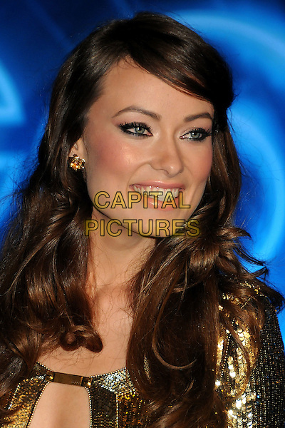 "OLIVIA WILDE .""TRON: Legacy"" L.A. Premiere held at the El Capitan Theatre, Hollywood, California, USA, 11th December 2010..portrait headshot fringe make-up beauty gold cut out sequined sequin blusher cheekbones eyeliner wavy hair smiling profile .CAP/ADM/BP.©Byron Purvis/AdMedia/Capital Pictures."