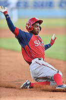 Hagerstown Suns center fielder Victor Robles (16) slides into third base during a game against the Asheville Tourists at McCormick Field on June 8, 2016 in Asheville, North Carolina. The Tourists defeated the Suns 10-8. (Tony Farlow/Four Seam Images)