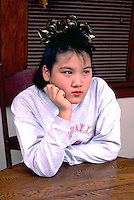 Korean American student age 15 deep in thought.  St Paul Minnesota USA