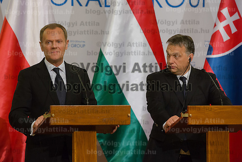 Donald Tusk (L) Prime Minister of Poland and Viktor Orban (R) Prime Minister of Hungary talk during a press conference after the special meeting of the prime ministers of the Visegrad 4 Group in Budapest, Hungary on January 29, 2014. ATTILA VOLGYI