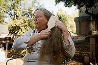 Arizona rancher Maryann Pratt takes a minute to brush her hair. (Pat Shannahan/ The Arizona Republic)