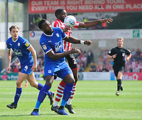 Lincoln City's John Akinde vies for possession with Tranmere Rovers' Emmanuel Monthe<br /> <br /> Photographer Chris Vaughan/CameraSport<br /> <br /> The EFL Sky Bet League Two - Lincoln City v Tranmere Rovers - Monday 22nd April 2019 - Sincil Bank - Lincoln<br /> <br /> World Copyright © 2019 CameraSport. All rights reserved. 43 Linden Ave. Countesthorpe. Leicester. England. LE8 5PG - Tel: +44 (0) 116 277 4147 - admin@camerasport.com - www.camerasport.com
