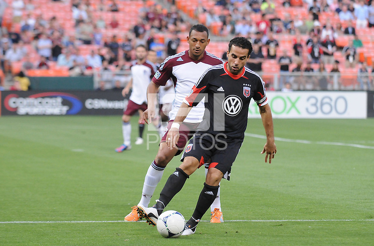 D.C. United forward Dwayne de Rosario (7) shields the ball from Colorado Rapids defender Tyrone Marshall (34) D.C. United defeated the Colorado Rapids 2-0 at RFK Stadium, Wednesday May 16, 2012.