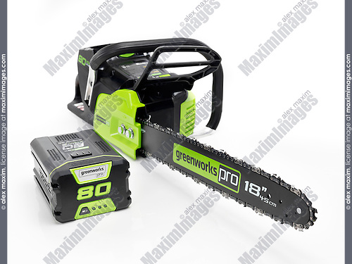 Electric Cordless chainsaw Greenworks and a large Lithium rechargeable battery isolated on white background