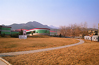 The Huaxia Winery Co Ltd (Great Wall Winery) wine making building. A mountain range in the background Beijing, China, Asia