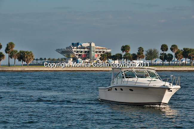 A boat coming in to St. Petersburgh, Florida from Tampa Bay with the colorful Pier of St. Petersburg in the background