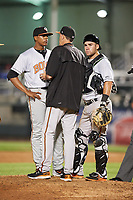 Bowie Baysox pitching coach Kennie Steenstra talks with relief pitcher Jesus Liranzo (30) and catcher Austin Wynns (19) during a game against the Harrisburg Senators on May 16, 2017 at FNB Field in Harrisburg, Pennsylvania.  Bowie defeated Harrisburg 6-4.  (Mike Janes/Four Seam Images)