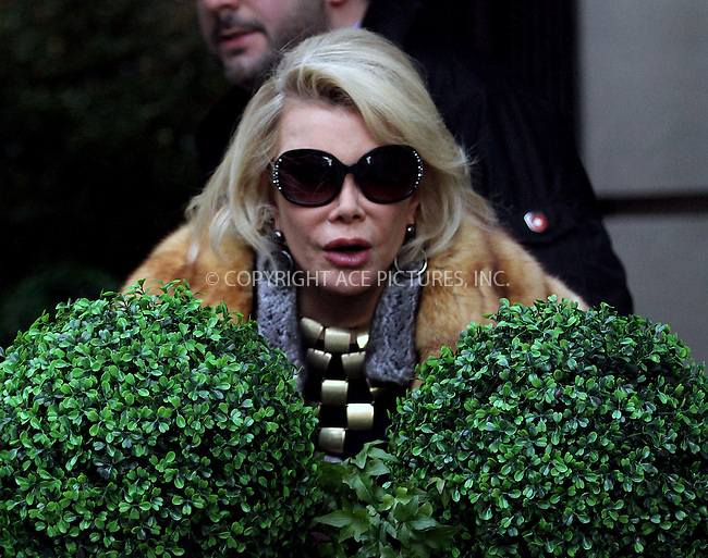 WWW.ACEPIXS.COM<br /> <br /> December 26 2013, New York City<br /> <br /> Comedian Joan Rivers walking with a friend on the Upper East Side of Manhattan on December 26 2013 in New York City<br /> <br /> By Line: Zelig Shaul/ACE Pictures<br /> <br /> <br /> ACE Pictures, Inc.<br /> tel: 646 769 0430<br /> Email: info@acepixs.com<br /> www.acepixs.com