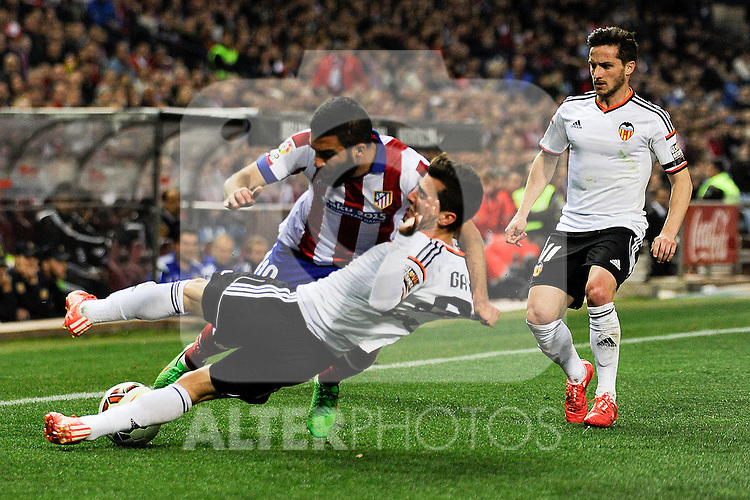 Atletico de Madrid´s Arda Turan and Valencia CF´s Jose Gaya during 2014-15 La Liga match between Atletico de Madrid and Valencia CF at Vicente Calderon stadium in Madrid, Spain. March 08, 2015. (ALTERPHOTOS/Luis Fernandez)