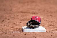 A hat and glove belonging to a Cleveland Indians first baseman between innings of an Extended Spring Training game against the Arizona Diamondbacks at the Cleveland Indians Training Complex on May 27, 2018 in Goodyear, Arizona. (Zachary Lucy/Four Seam Images)