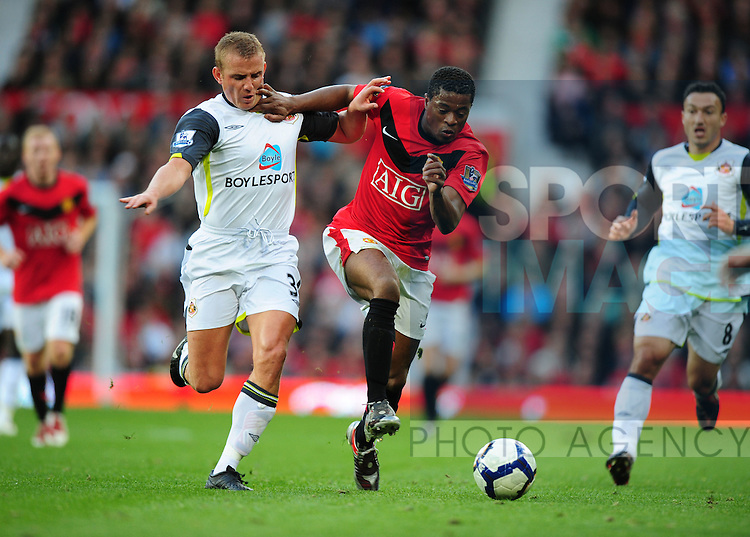 Lee Cattermole of Sunderland challengses Patrice Evra of Manchester United