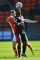 Milton Keynes Dons' Kieran Agard competes with Blackpool's Oliver Turton<br /> <br /> Photographer Richard Martin-Roberts/CameraSport<br /> <br /> The EFL Sky Bet League One - Blackpool v Milton Keynes Dons - Saturday August 12th 2017 - Bloomfield Road - Blackpool<br /> <br /> World Copyright &copy; 2017 CameraSport. All rights reserved. 43 Linden Ave. Countesthorpe. Leicester. England. LE8 5PG - Tel: +44 (0) 116 277 4147 - admin@camerasport.com - www.camerasport.com