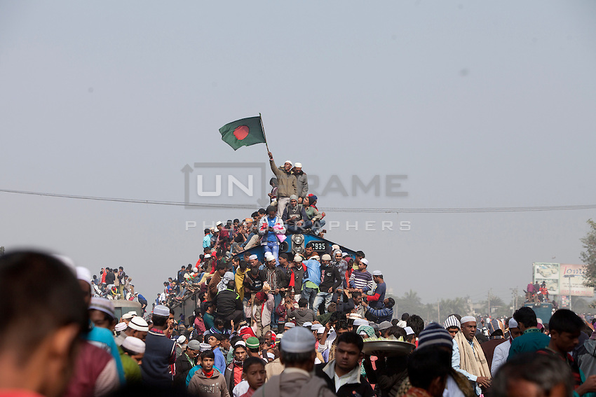 Muslim devotees hold Bangladesh's national flag on an over-crowded train as they return home after a three-day World Congregation of Muslims, or Biswa Ijtema, on the banks of the River Turag just outside  Dhaka, Bangladesh. Jan 11, 2015