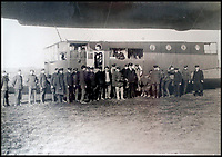 BNPS.co.uk (01202 558833)<br /> Pic:  PeterWilson/BNPS<br /> <br /> Military personnel pose for a photo by the R34 airship.<br /> <br /> A charming letter which was carried on the first airship to cross the Atlantic has come to light 100 years later.<br /> <br /> Reverend George Jones, who was stationed at the Royal Naval Air Station East Fortune near Edinburgh, wanted to surprise his sister Donie by sending her a letter from America.<br /> <br /> So he gave the letter to one of the crew of airship R34 ahead of the historic flight on July 2, 1919, and asked him to post it to Donie from New York.<br /> <br /> He obliged and the letter reached its final destination in Bournemouth, Dorset, several months later as it made the return journey via ship.