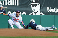 Third Baseman Richie Shaffer #8 of the Clemson Tigers applies a tag to the hard sliding Tommy Coyle during  a game against the North Carolina Tar Heels at Doug Kingsmore Stadium on March 9, 2012 in Clemson, South Carolina. The Tar Heels defeated the Tigers 4-3. Tony Farlow/Four Seam Images.