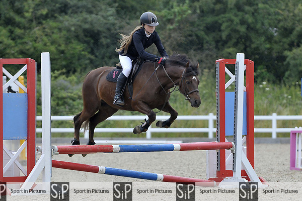 Class 4. 65cm. Unaffiliated showjumping. Brook Farm Training Centre. Essex. 15/07/2017. MANDATORY Credit Garry Bowden/Sportinpictures - NO UNAUTHORISED USE - 07837 394578