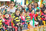Children from Bellview Woods child care wave at the dignitaries on the mains stand at the Killarney St Patricks day parade on Saturday