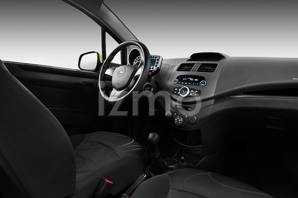 Passenger side dashboard view of a 2011 Chevrolet Spark LS 5 Door Hatchback  .