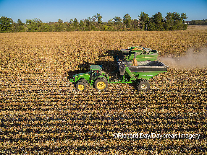 63801-08212 Corn Harvest, John Deere combine unloading corn into grain cart while harvesting - aerial Marion Co. IL