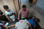 Palestinian photojournalist Mohammad al-Arbid, lays on a hospital bed as he receiving medical treatment after he was wounded by an Israeli security forces during a protest calling for end the Israeli blockade on Gaza Strip, in the east of Gaza city, on July 22, 2019. Demonstrators demand an end to Israel's 12-year blockade of the Gaza Strip, which has shattered the coastal enclave's economy and deprived its two million inhabitants of many basic amenities. Photo by Mahmoud Ajjour