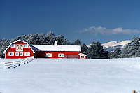 Red barn in winter snow.