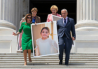 United States Senate Minority Leader Chuck Schumer (Democrat of New York) and Speaker of the United States House of Representatives Nancy Pelosi (Democrat of California) carry a photo of New York resident Emilie Saltzman, who suffered a traumatic brain injury, to a press conference on Capitol Hill in Washington D.C., U.S. to discuss health care coverage for those with pre-existing conditions on July 9, 2019.<br /> CAP/MPI/RS<br /> ©RS/MPI/Capital Pictures