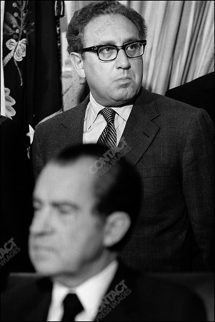 US Secretary of State, Henry Kissinger, stands behind American President Richard Nixon during the signing of an agreement with President Nicolae Ceausescu of Romania. Washington DC, USA, December 5, 1973