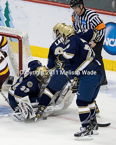 Mike Johnson (Notre Dame - 32), Joe Lavin  (Notre Dame - 33), Stephen Johns (Notre Dame - 28) - The University of Minnesota-Duluth defeated the University of Notre Dame Fighting Irish 4-3 in their 2011 Frozen Four Semi-Final on Thursday, April 7, 2011, at the Xcel Energy Center in St. Paul, Minnesota.