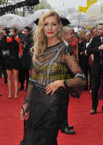 Tess Daly.Arqiva British Academy Television Awards in 2013 at the Royal Festival Hall, London, England..12th May 2013.BAFTA BAFTAS half length black sheer hand on hip beads beaded dress red lipstick  .CAP/DS.©Dudley Smith/Capital Pictures