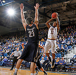 BROOKINGS, SD - OCTOBER 29:  George Marshall #11 from South Dakota State spots up for a jumper over Brian Orr #21 from South Dakota School of Mines in the first half of their exhibition game Thursday night at Frost Arena in Brookings. (Photo by Dave Eggen/Inertia)