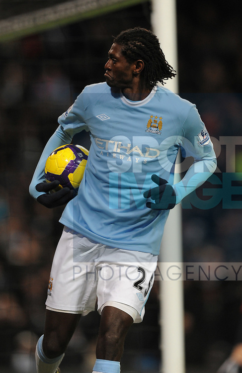 Emmanuel Adebayor of Manchester City collects the ball and pouts after scoring the second goal