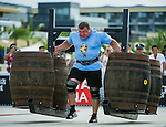 HAINAN ISLAND, CHINA - AUGUST 23:  Vytautas Lalas of Lithuania competes at the Super Yoke event during the World's Strongest Man competition at Serenity Marina on August 23, 2013 in Hainan Island, China.  Photo by Victor Fraile
