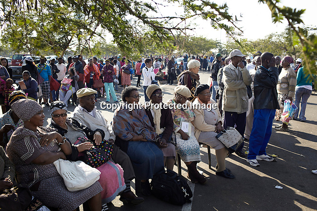 SOWETO, SOUTH AFRICA APRIL 30: Pensioners wait to get their monthly state pension payout on the parking lot at the Jabulani shopping mall on May 30 2013, Soweto, South Africa. The mall is one of many new developments in the township helping the people to buy food and goods locally instead of traveling to Johannesburg. Soweto today is a mix of old housing and newly constructed townhouses. The population in Soweto is estimated to be around one million people. A new hungry black middle-class is growing steadily. Many residents work in Johannesburg but the last years many shopping malls have been built, and people are starting to spend their money in Soweto. (Photo by: Per-Anders Pettersson)