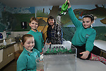 Welsh Water.Scarlett Lee, Dylan Richards & Jenny Corcoran from Bynea Primary School in Llanelli with Welsh Water teacher Mary Watkins learning about surface Water flooding...01.02.12.©Steve Pope