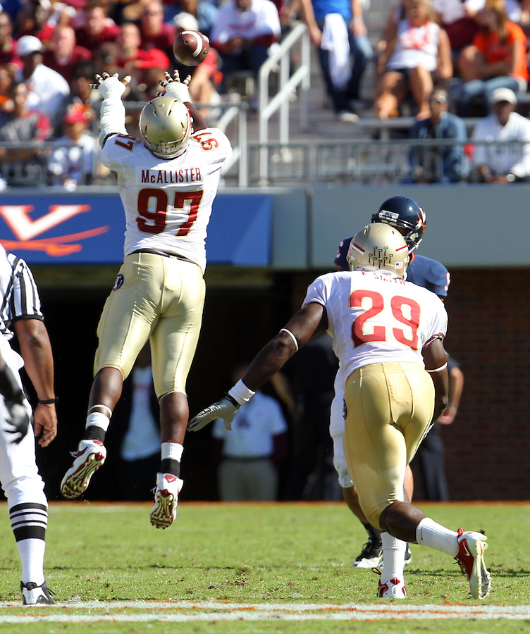 Oct 2, 2010; Charlottesville, VA, USA; Florida State Seminoles defensive tackle Demonte McAllister (97)blocks a pass from Virginia Cavaliers quarterback Marc Verica (6) as teammate Florida State Seminoles linebacker Kendall Smith (29) looks on during the 2nd half of the game at Scott Stadium. Florida State won 34-14.  Photo/The Daily Progress/Andrew Shurtleff