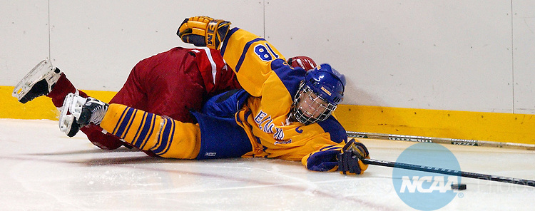9 MAR 2002: Forward Michelle Rennie (18) of Elmira College stretches for the puck after being checked by a Manhattenville College player during the Division 3 Women's Ice Hockey Championship held at the Murray Athletic Center at Elmira College in Horseheads, NY.  Elmira College defeated Manhattanville College 2-1 for the championship title.   Stephen Cannerelli/NCAA Photos