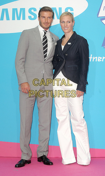 David Beckham & Zara Phillips.Samsung kicks-off its London 2012 campaign 'Everyone's Olympic Games', Canary Wharf, London, England..13th June 2011.full length grey gray suit jacket stubble trousers beard facial hair blazer black white.CAP/BEL.©Tom Belcher/Capital Pictures.