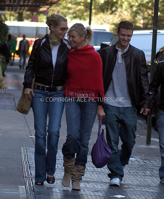 *** EXCLUSIVE ***..*** FEE MUST BE AGREED BEFORE USE ***..Cameron Diaz and Justin Timberlake having fun with a couple of friends while taking a stroll in Manhattan. The happy couple were seen going to Barney's New York after they left their Manhattan hotel. They spent about two hours shopping after which Timberlake was picked up by his bodyguard and was off to rehearsals for upcoming 'Saturday Night Live.' ....Diaz tried to hide her face while walking. Her face looked swollen and her nose was deformed. Diaz was sporting a nasty scar across her nose. ....The Charlie's Angels star broke her nose in August on Waikiki Beach, Hawaii, during a freak surfing accident. Cameron was surfing with her older sister and two friends when she wiped out and someone's board hit her in the face.....New York, October 7, 2003. Please byline: NY Photo Press.   ..*PAY-PER-USE*      ....NY Photo Press:  ..phone (646) 267-6913;   ..e-mail: info@nyphotopress.com