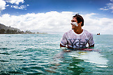 USA, Oahu, Hawaii, portrait of MMA Mixed Martial Arts Ultimate fighter Lowen Tynanes surfing at Pipeline Beach on the North Shore of Oahu