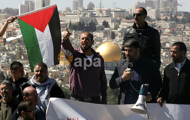 Palestinian protesters demonstrate near the Dome of the Rock in the Al-Aqsa mosque compound against a decision by the Jerusalem municipality and Israel's Nature and Parks Authority (NPA) to build a national park on Palestinian land in Arab east Jerusalem on March 9, 2012. The planning and construction commission of Jerusalem gave the go ahead for the establishment of a 5,000 square metre tourist complex in Silwan, a move that will likely further raise tensions in the flashpoint neighbourhood. Photo by Mahfouz Abu Turk